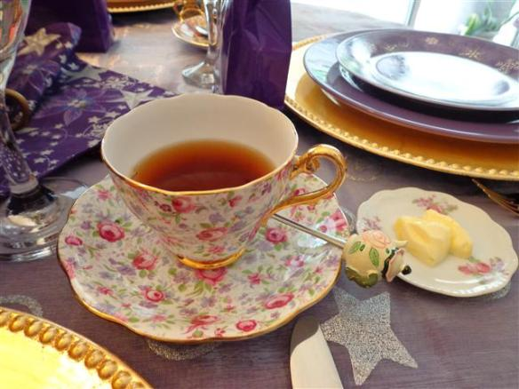 Mad Hatter tea from the White Heather Tea Room in Victoria, BC. Look at the cute teacup shaped butter pat next to the tea!)