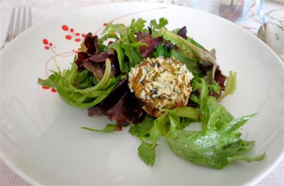 Stuffed mushroom cap with mesclun herb salad