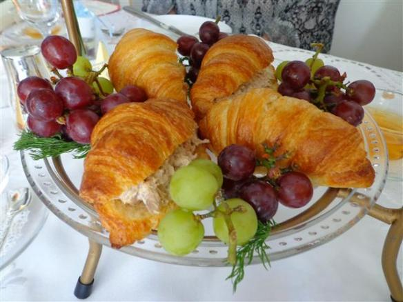 Tuna salad croissant sandwiches and fresh fruit course: grape bunches