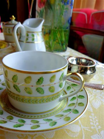 Tea cup with tea strainer