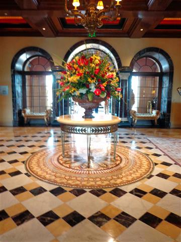 Foyer with fresh flower display. This is one of the biggest fresh floral displays I've seen. I can't imagine it getting replaced every few days!