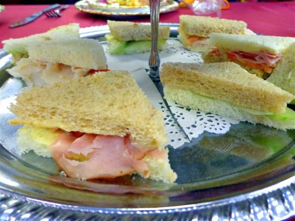 Ham and tomato sandwich, cucumber sandwich, turkey and tomato sandwich