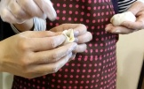 Add 1 tsp. of filling and fold the dumpling